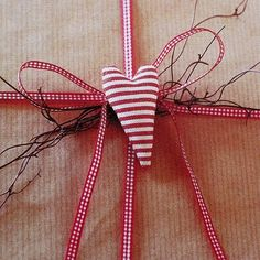 red ticking heart and red gingham ribbon