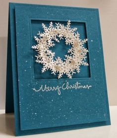 Recessed snowflakes wreath with sliver glimmer stars and splattered white ink