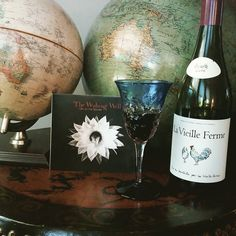 Toasting the end of a good day with a glass of French wine and a fantastic album by Australia's #thewishingwell. #lavieilleferme #frenchwine #redredwine #vintageglobe #vintagefurniture #tibetanfurniture