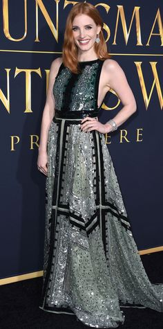 Jessica Chastain glittered at The Huntsman: Winter's War premiere in a sage silk Altuzarra handkerchief hem gown embroidered with intricate metallic silver sequins, adding onto the shine with a set of drop diamond earrings and bracelet.