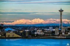 The Cascade foothills covered in snow provide a spectacular backdrop to the Emerald City during tonights sunset on Tuesday, February 2, 2016.  Photo © 2016 David Rosen / SlickPix Photography