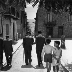 Sicilian-born gangster Charles 'Lucky' Luciano walking down a street in his native Sicily. Poster Print by Slim Aarons at the Condé Nast Collection