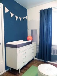 Annie chose a vintage dresser as a changing table, adding to the room's midcentury flavor. Dig!