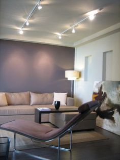 Gray Purple. This deep, muted gray is very serene and calming. Its gray undertones make it a great choice for contemporary spaces. Paint Pick: Beguiling Mauve 6269 by Sherwin Williams (Accent wall leading to Playroom with French Doors)
