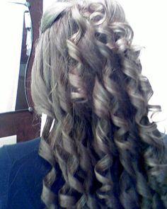 Half up, half down, with curls. cute!