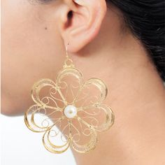 This contemporary statement earring is specially curated by pookaari and  comes with delicate filigree work in a floral pattern. It is embellished with a white pearl at the center. Shop now at http://pookaari.com/jewellery/ritika-sachdeva/bloom.html . Call us on +918489769723