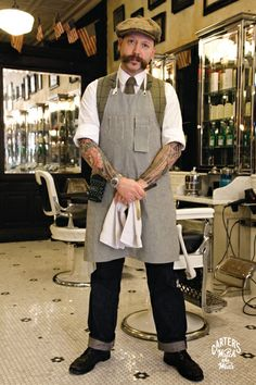 "Barber ""Russell"" in Brooklyn, NY wearing the Carpenter Apron by Carter's Overalls."