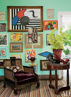 In the living room of Sig Bergamin's São Paulo house, art by Alexander Calder, Carla Barth, and others hangs behind a chinoiserie chair.
