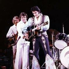 Elvis Presley and Charlie Hodge on stage