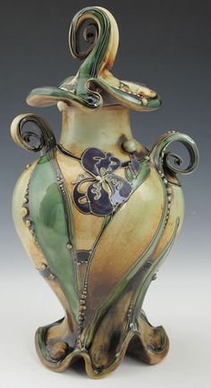 Carol Long's work is sumptuous like pulled taffy and highly decorated french candies all rolled into clay goodness :) ~BR.