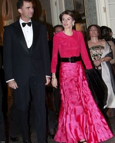 Princes Letizia, pictured here with Felipe arriving to a gala dinner at Soto de Vinuelas Palace in Madrid, has become a fashion and style ic...