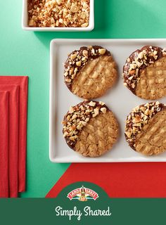 These peanut butter cookies look classy, but are simple to make: Just dip peanut butter cookies into melted dark chocolate and top with chopped Spanish peanuts.