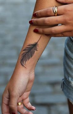 Indian Plume Feather Tattoo Ideas for Women - Black Arm Wrist Tat - MyBodiArt.com #TattooDesignsArm