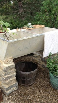 I've been scouring Craigslist, flea markets and antique stores to try to find an outdoor sink like this beauty. It will make a great prep station for gatherings, and a quick place to wash veggies and hands. And I love the rustic stone used as support.