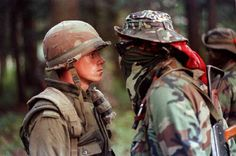 Mohawk Warrior Brad Larocque taunts Pte. Patrick Cloutier during the Oka Crisis ca. 7/11-9/26 1990 [500x332]