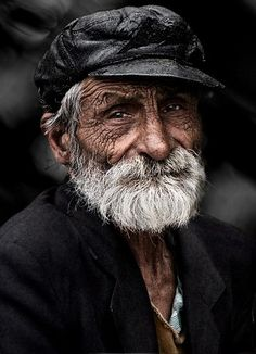 ALTphotos Photography Community.  The old man with wrinkly skin looking straight into the camera. So natural. So much experience from a long life.