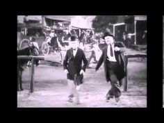 Laurel and Hardy dancing to AC/DC's 'Shot down in Flames'