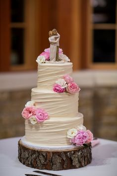Romantic wedding cake idea - three-tier buttercream-frosted wedding cake with pink flowers {Jennifer Weems Photography}
