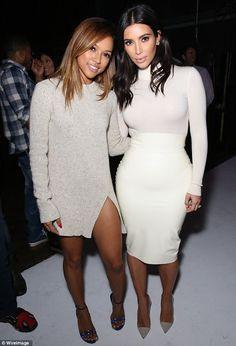 Kim Kardashian's friend pretends to bite her derriere in a photo booth #dailymail