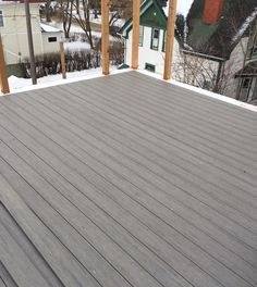 Rooftop patio composite deck under construction: Timber Tech Earthwood Evolutions Terrain in silver maple.