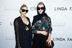 (L to R)  Elena Perminova and Ulyana Sergeenko attend a dinner to launch the luxury British eyewear brand SS17 campaign during Paris Fashion Week at Alcazar Club on October 3, 2016 in Paris, France.
