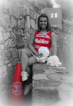 """Cheer Portrait Inspiration - """"Yes, cheerleading is a sport!""""  I love how the black-and-white background allows the school colors  to be featured so beautifully in this portrait.  -LRE"""