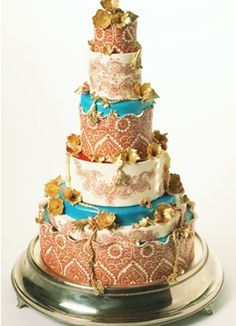 Over the top Mehndi inspired teal and brown Indian Wedding Cake with fresh flowers