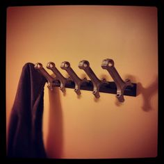 Connecting rod coat rack.