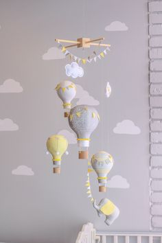 Yellow and Grey Gender Neutral Nursery Mobile, Hot Air Balloon Baby Mobile, Elephant Travel Theme, Circus Nursery Decor, i80 by sunshineandvodka on Etsy https://www.etsy.com/listing/228306171/yellow-and-grey-gender-neutral-nursery