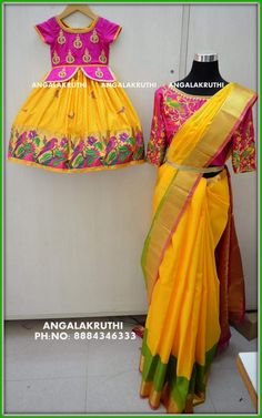 Mother and Daughter matching dress designs by Angalakruthi boutique Bangalore Saree matching with kid dress Hand Embroidery designs by Angalakruthi boutique Embroidery Blouse designs by Angalakruthi boutique Bridal wear designs