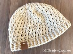 The double cluster crocheted hat is made with 2 double crochet clusters and a ribbed edge made with alternating front and back post stitches.