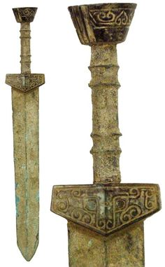 """Solid bronze ancient Asian sword, the bottom of the handle is made of jade with a decorative pattern. Encrusted with earthen deposits.       400 - 200 BC  15"""""""