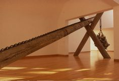 Tusk-Drop-second view 14'x25'x16', Pit-fired Unglazed clay, chain, wood. [Installed 1990 Des Moines Art Center, IA ]