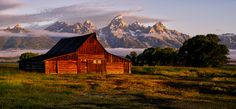 © Jeff R. Clow When people see the first light hit the Moulton Barn, they finally realize that getting up at a. on this particular morning was worth all the effort. Grand Teton National Park, National Parks, Hanging Clouds, Spring Photos, Barn Lighting, Old Barns, Rest Of The World, Photo Contest, The Row
