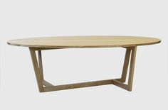 Veer Dining Table - This striking elliptical oak table lends itself to social…