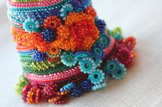 Templetonia Retusa ... Freeform Crochet Bracelet - Beaded Flowers - Indigo Blue Green Orange Red Colors by irregularexpressions | Flickr - P...