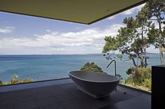 Tub with a view at Cliff House in Auckland, New Zealand by Fearon Hay Architects.