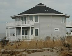 John and Kathy G. built a Deltec for a vacation getaway on the southern tip of NJ. Constructed in 2010 in Del Haven, the 2,000-sq-ft home situated on Delaware Bay has panoramic views of the water and wetlands. The two-story house stands on pilings six feet off the ground, with sleeping quarters on the first level and living room, dining room and kitchen on the second level in an open floor. More: http://www.motherearthnews.com/green-homes/deltec-homes.aspx#ixzz2Z28m4qDg