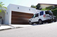 Garage Door Modern Sleek Reflective With Parked White Land Rover Suv Contemporary Garage Doors, Modern Garage Doors, Modern Contemporary, Land Rover Suv, Joe's Garage, Garage Door Installation, Royce, Van, Exterior