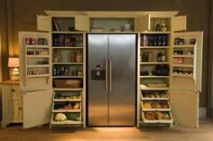 I would put countertops on either side of the refrigerator to separate the pantries from the fridge, but otherwise, this is my dream!