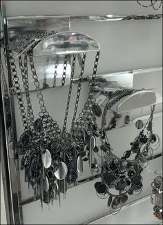 Plastic Hooks with neck-like openings to display jewelry have been featured before. Here is an upscale chrome variant of a… Slat Wall, Jewellery Display, Chrome, Chandelier, Ceiling Lights, Mirror, Hooks, Jewelry, Home Decor