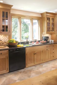 kitchen ideas. The natural wood light color would be perfect for my small kitchen. love the window!
