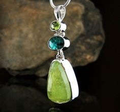 "From top to bottom: Peridot, Ocean Kyanite (Australia) and Grossular Garnet (Africa) set in a ""one-of-a-kind"" Sterling Silver Pendant."