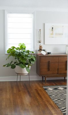 Mid century dresser. Love the legs on it. A Modernized Charmer For Creatives in Pennsylvania | Design*Sponge