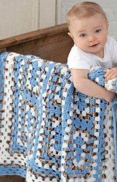 Around the Block Baby Blanket Crochet Pattern - Whether baby is traveling around the block in a stroller or off to relatives house, this blanket will be there to comfort or provide a place to lie down and view the world. Crochet the nine rectangle granny squares in any three colors for a perfect gift.