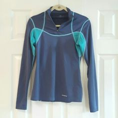 Patagonia Long Sleeve Half Zip .pop is 100% polyester has been washed and worn with no major stains or rips.  Small pocket with cover on lower back right side. Patagonia Tops Tees - Long Sleeve
