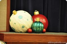 Breakfast with Santa idea - giant ornaments made from yoga balls. White ornament is covered in strips of burlap and the tops are cool whip containers.