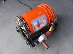 Parts Tumbler by Brian1 -- Homemade parts tumbler constructed from a Home Depot bucket and repurposed air conditioner components. Tumbler is powered by an electric drill through a belt-driven pulley arrangement. http://www.homemadetools.net/homemade-parts-tumbler