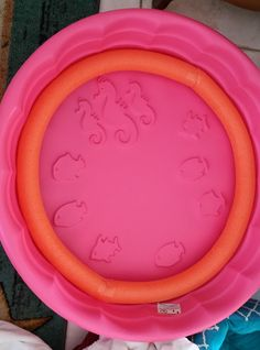Whelping pool bumpers for sides. I took a hoola-hoop & 2 pool noodles. Slit the noodles, inserted hoop, taped ends of noodles together. Cover with pad and blanket. Next adding PVC pipe for puppy safety.
