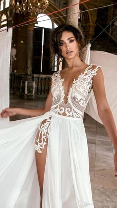 Sexy Deep V Neck Beach Wedding Dresses Side High Slit Lace Appliqued Illusion Bodice Sweep Train Bohomian Wedding Bridal Gowns is part of Bohemian wedding dress lace Condition Brand New Custo - Dresses Elegant, Sexy Wedding Dresses, Lace Wedding, Wedding Dress Beach, Dresses Dresses, Reception Dresses, Bridesmaid Dresses, Slit Wedding Dress, Wedding Dress Types